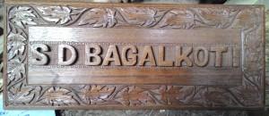 artisans of kashmir, kashmir artisans, walnut wood, walnut wood craft, crafts of kashmir, kashmir crafts, kashmir arts, kashmir, walnut wood, walnut wood décor, walnut wood bed, ghulam ahamd najar, najar, imtiyaz ahamd najar, walnut wood artisans, name plates, walnut wood name plates, walnut wood calligraphy